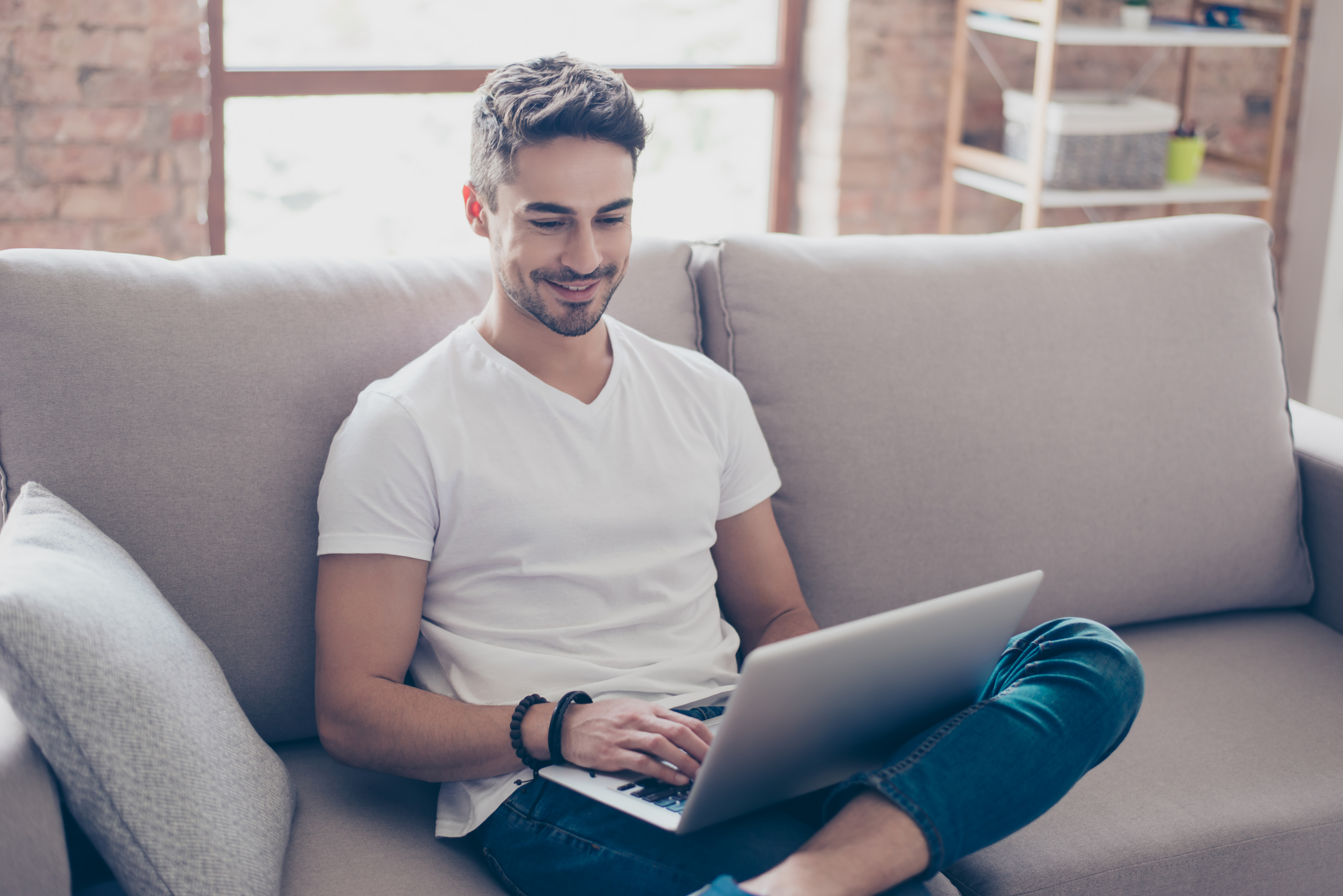 Interracial Dating Man Browsing Laptop
