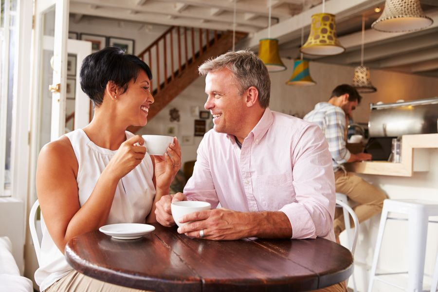 Mature couple having coffee together